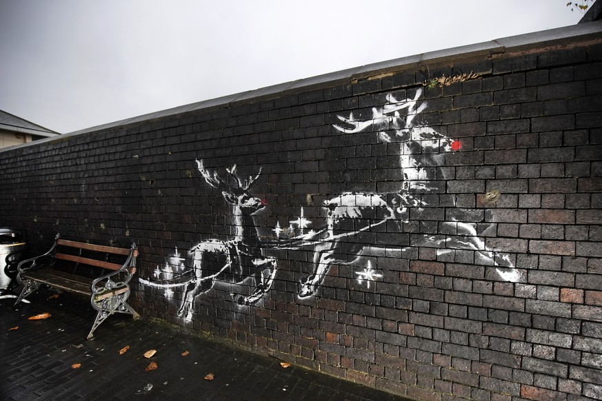 BIRMINGHAM, ENGLAND - DECEMBER 10: Red noses have appeared on Banksy's Birmingham homeless reindeer mural , which has also been fenced off to protect the artwork,  on a railway bridge wall in Vyse Street on December 10, 2019 in Birmingham, England. The elusive British artist unveiled the artwork in a video posted to his social media accounts on Monday, Dec. 9, and has been dubbed