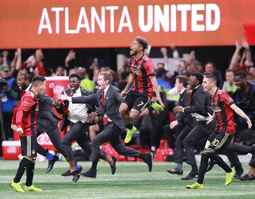 December 8, 2018 - Atlanta, GA, USA - Atlanta United s Josef Martinez leaps in the air and Miguel Almiron charges the field celebrating winning the MLS Fussball Herren USA Cup 2-0 over the Portland Timbers on Saturday, Dec 8, 2018, in Atlanta. Atlanta United defeates Timbers to win MLS Cup PUBLICATIONxINxGERxSUIxAUTxONLY - ZUMAm67_ 20181208_zaf_m67_053 Copyright: xCurtisxComptonx
