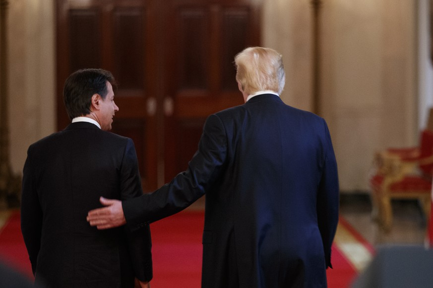 President Donald Trump walks from the podiums with Italian Prime Minister Giuseppe Conte after a news conference in the East Room of the White House, Monday, July 30, 2018, in Washington. (AP Photo/Evan Vucci)