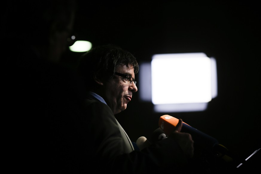 Former Catalan leader Carles Puigdemont addresses the media during a news conference in Berlin, Germany, Tuesday, May 15, 2018. (AP Photo/Markus Schreiber)