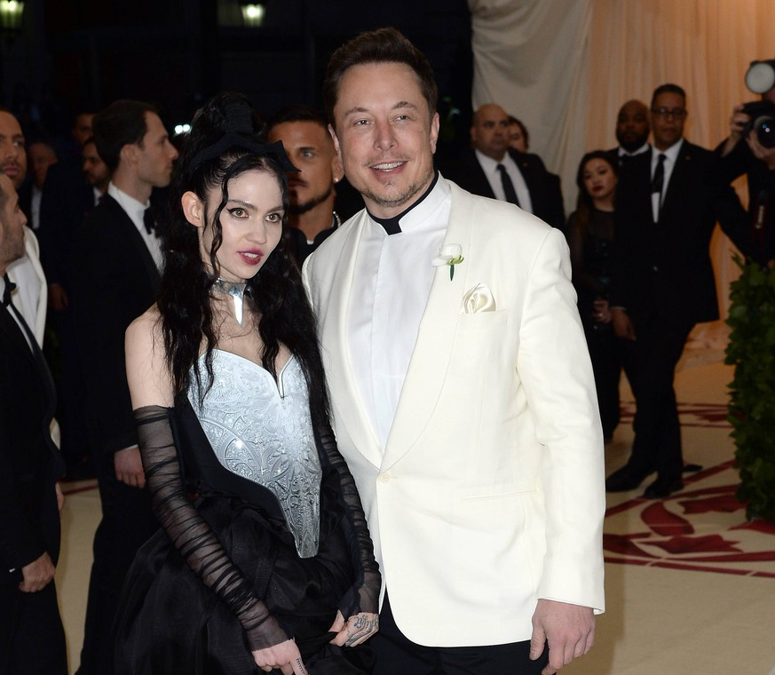 May 7, 2018 - New York, New York, United States - Elon Musk and Grimes arriving at Heavenly Bodies: Fashion & The Catholic Imagination Costume Institute Gala at the Metropolitan Museum of Art on May 7, 2018 in New York City New York United States PUBLICATIONxINxGERxSUIxAUTxONLY - ZUMAny1 20180507zafny1572 Copyright: xKristinxCallahanx