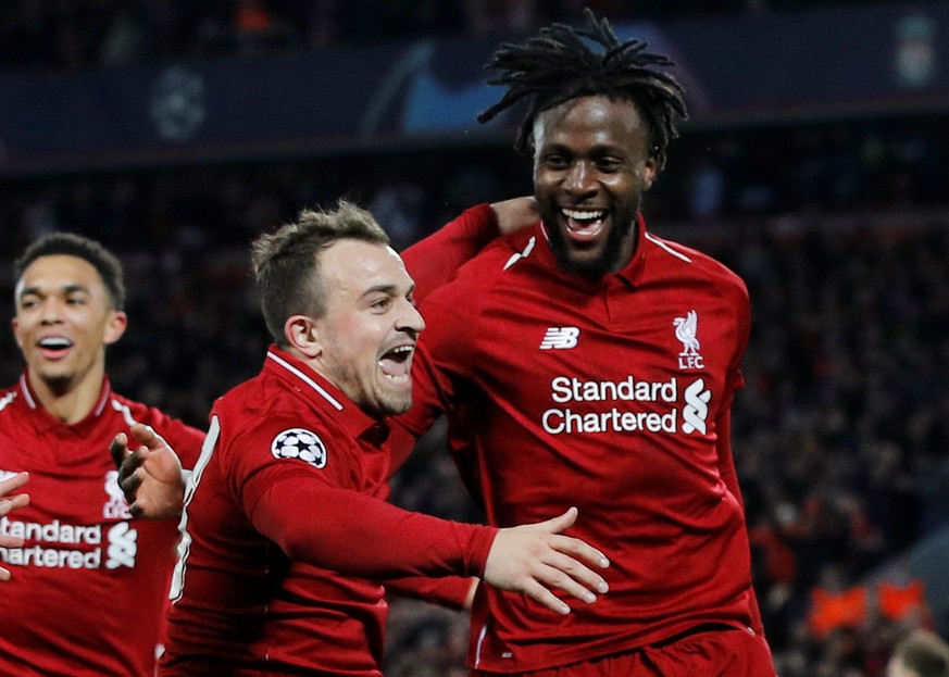 Soccer Football - Champions League Semi Final Second Leg - Liverpool v FC Barcelona - Anfield, Liverpool, Britain - May 7, 2019  Liverpool's Divock Origi celebrates scoring their fourth goal with Xherdan Shaqiri and Trent Alexander-Arnold   REUTERS/Phil Noble