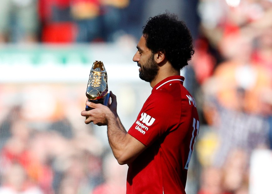 Soccer Football - Premier League - Liverpool vs Brighton & Hove Albion - Anfield, Liverpool, Britain - May 13, 2018   Liverpool's Mohamed Salah celebrates with the Golden Boot after the match   REUTERS/Phil Noble    EDITORIAL USE ONLY. No use with unauthorized audio, video, data, fixture lists, club/league logos or