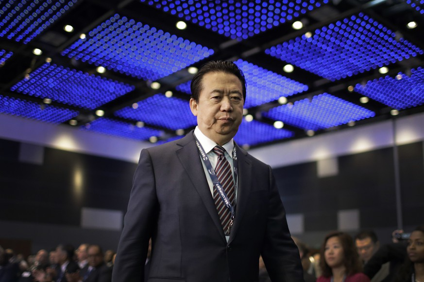 FILE - In this July 4, 2017 file photo, Interpol President, Meng Hongwei, walks toward the stage to deliver his opening address at the Interpol World congress in Singapore. A French judicial official says Friday Oct.5, 2018 the president of Interpol has been reported missing after traveling to China. (AP Photo/Wong Maye-E, File)
