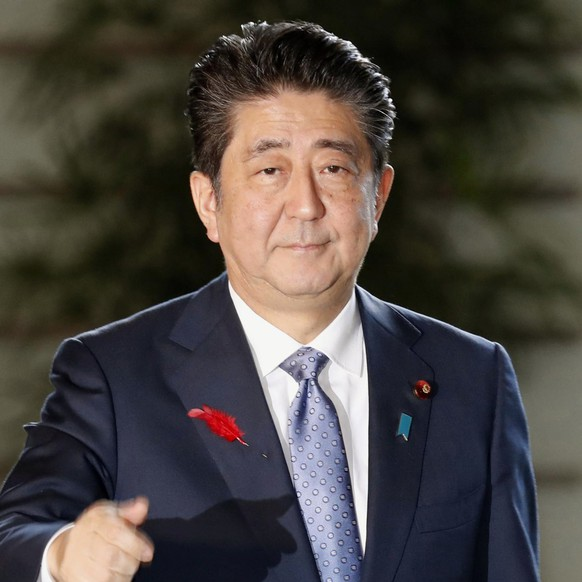 Japan's Prime Minister Shinzo Abe arrives at his prime minister's office in Tokyo Tuesday, Oct. 2, 2018.   Abe is scheduled to reshuffle his Cabinet after his re-election as president of the ruling party, retaining key diplomatic and economy posts for continuity as Japan tackles challenging trade talks with the U.S.(Yohei Kanasashi/Kyodo News via AP)