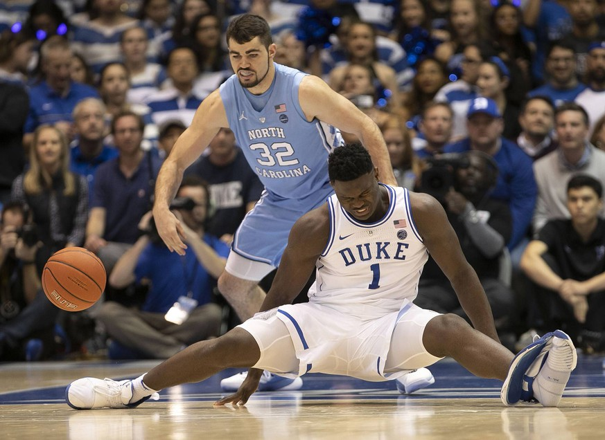 February 20, 2019 - Durham, NC, USA - Duke s Zion Williamson (1) falls to the court under North Carolina s Luke Maye (32), injuring himself and damaging his shoe during the opening moments of the game in the first half on Wednesday, Feb. 20, 2019, at Cameron Indoor Stadium in Durham, N.C. Phil Rosenthal: Zion Williamson shouldn t have been playing anyway PUBLICATIONxINxGERxSUIxAUTxONLY - ZUMAm67_ 20190220_zaf_m67_029 Copyright: xRobertxWillettx