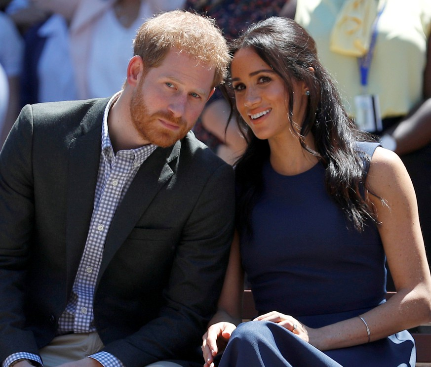 FILE PHOTO: Britain's Prince Harry and his wife Meghan, Duchess of Sussex, watch a performance during their visit to Macarthur Girls High School in Sydney, Australia October 19, 2018. REUTERS/Phil Noble/Pool/File Photo