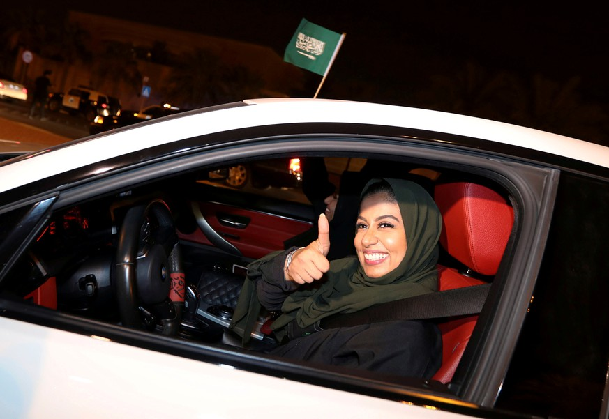 A Saudi woman celebrates as she drives her car in her neighborhood, in Al Khobar,  Saudi Arabia, June 24, 2018. REUTERS/Hamad I Mohammed     TPX IMAGES OF THE DAY