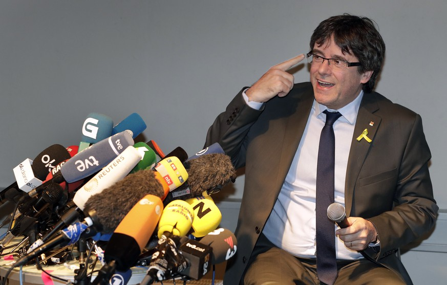 Former Catalan leader Carles Puigdemont gestures during a news conference in Berlin, Germany, Saturday, April 7, 2018. Puigdemont was released on bail from the prison in Neumuenster, northern Germany, Friday. He was detained by German police March 25 after crossing the border from Denmark. Spain is seeking his extradition for rebellion and misuse of public funds in organizing an unauthorized referendum last year on Catalonia's independence from Spain. (AP Photo/Michael Sohn)