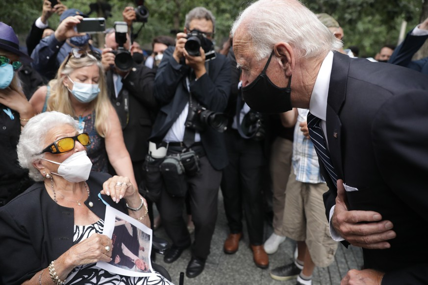 NEW YORK, NEW YORK - SEPTEMBER 11: Democratic presidential nominee Joe Biden meets with Maria Fisher, 90, whose son Andrew Fisher was killed in north World Trade Center tower, during a 9/11 memorial service at the National September 11 Memorial and Museum on September 11, 2020 in New York City. The ceremony to remember those who were killed in the terror attacks 19 years ago will be altered this year in order to adhere to safety precautions around COVID-19 transmission. (Photo by Amr Alfiky - Pool/Getty Images)