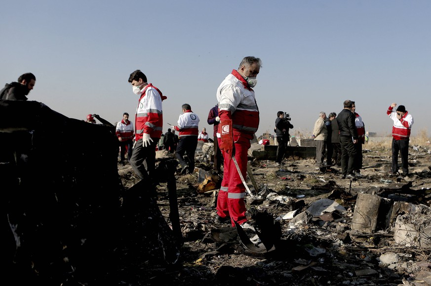 200109 -- BEIJING, Jan. 9, 2020 -- Rescuers work at the air crash site of a Boeing 737 Ukrainian passenger plane in Parand district, southern Tehran, Iran, on Jan. 8, 2020. All the 179 passengers and crew members on board the Boeing 737 Ukrainian passenger plane that crashed near Tehran Imam Khomeini International Airport IKA on Wednesday morning were confirmed dead, Iran s Press TV reported. Photo by /Xinhua XINHUA PHOTOS OF THE DAY AhmadxHalabisaz PUBLICATIONxNOTxINxCHN