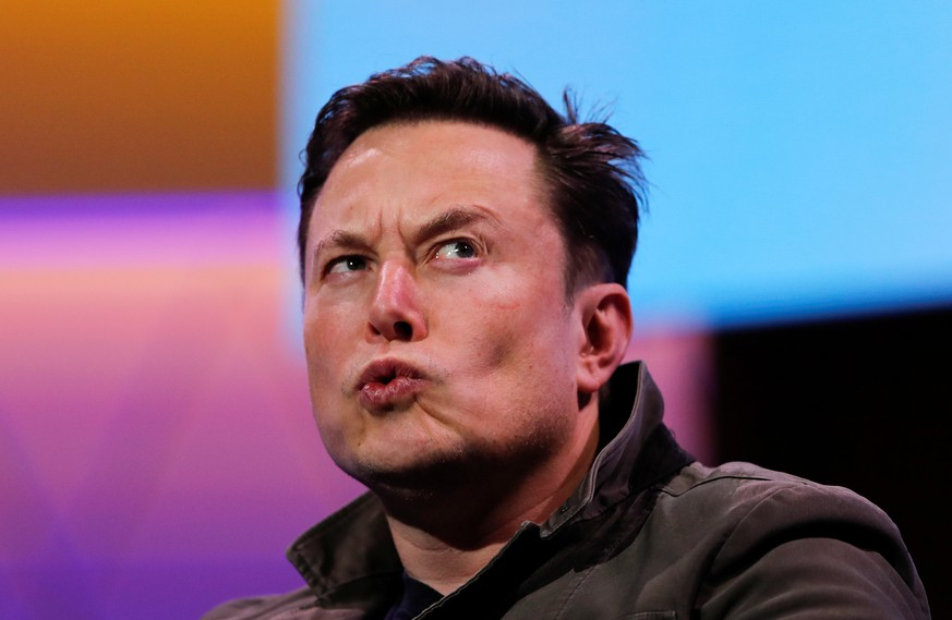 SpaceX owner and Tesla CEO Elon Musk reacts during a conversation with legendary game designer Todd Howard at the E3 gaming convention in Los Angeles California U.S