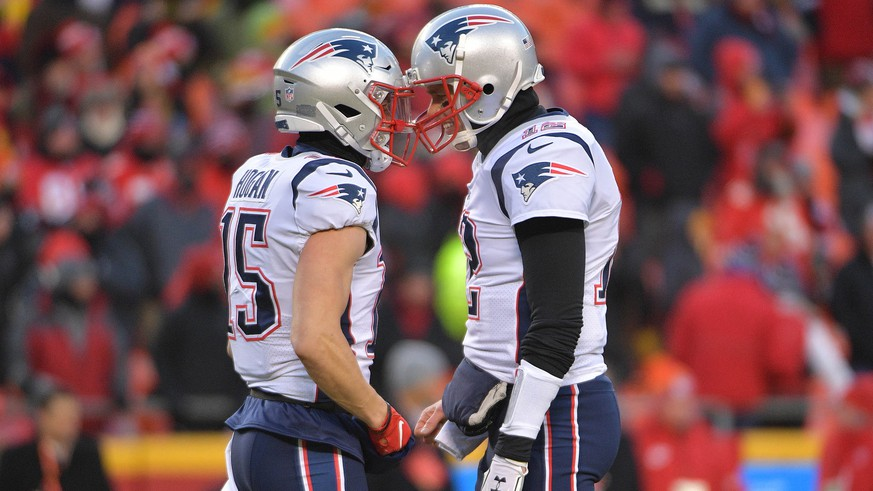 Jan 20, 2019; Kansas City, MO, USA; New England Patriots quarterback Tom Brady (12) and New England Patriots wide receiver Chris Hogan (15) talk prior to their  AFC Championship game against the Kansas City Chiefs at Arrowhead Stadium. Mandatory Credit: Denny Medley-USA TODAY Sports