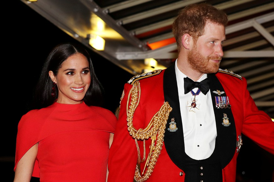 FILE PHOTO: Britain's Prince Harry and his wife Meghan, arrive to attend the Mountbatten Festival of Music at the Royal Albert Hall in London, Britain March 7, 2020. REUTERS/Simon Dawson/Pool/File Photo