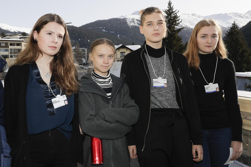 Climate activists Luisa Neubauer, Greta Thunberg, Isabelle Axelsson and Loukina Tille, from left, arrive for a news conference in Davos, Switzerland, Friday, Jan. 24, 2020. The 50th annual meeting of the forum is taking place in Davos from Jan. 21 until Jan. 24, 2020 (AP Photo/Markus Schreiber) |