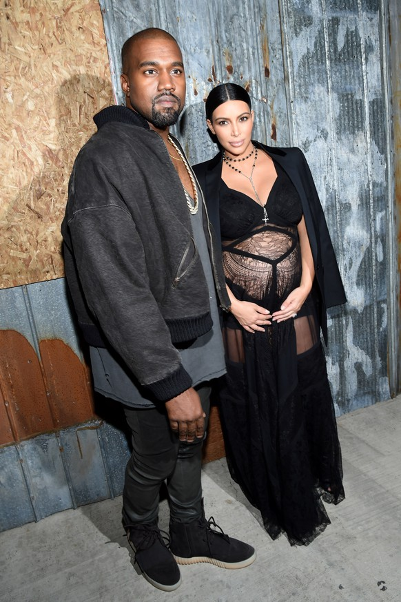 NEW YORK, NY - SEPTEMBER 11:  Rapper Kanye West (L) and television personality Kim Kardashian attend the Givenchy fashion show during Spring 2016 New York Fashion Week at Pier 26 at Hudson River Park on September 11, 2015 in New York City.  (Photo by Larry Busacca/Getty Images)