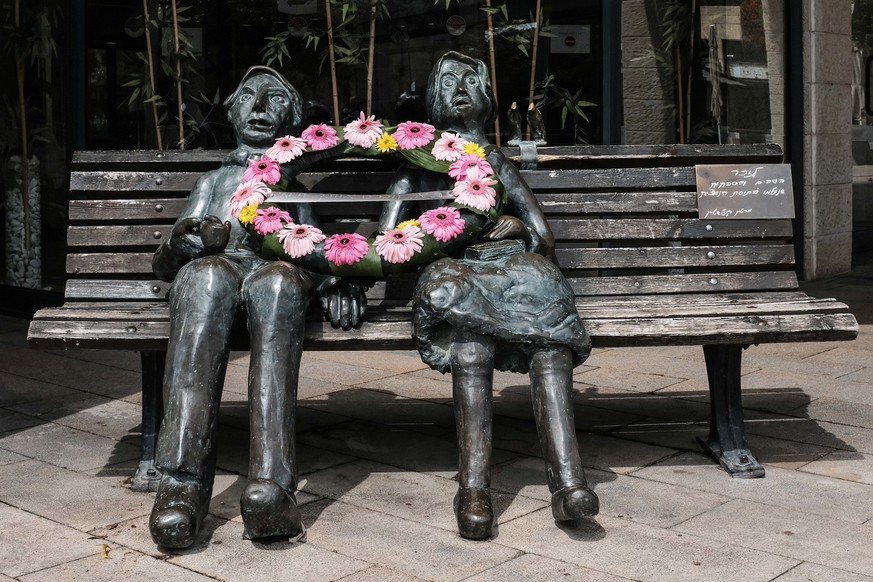 April 21, 2020, Jerusalem, Israel: A flower wreath lies on a statue created by Dr. Martin Kizelstein, Holocaust survivor, in memory of grandmothers and grandfathers that perished in the Holocaust, on Holocaust and Heroism Remembrance Day. (Credit Image: © Nir Alon/ZUMA Wire |
