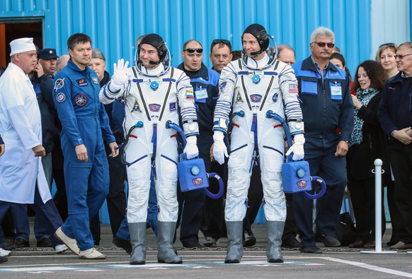 KAZAKHSTAN - OCTOBER 11, 2018: Roscosmos cosmonaut Alexei Ovchinin and NASA astronaut Nick Hague (L-R centre) of the ISS Expedition 57/58 prime crew wear suits at a send-off ceremony ahead of their Soyuz MS-10 space flight scheduled to start on October 11, 2018 with the Soyuz-FG rocket booster launch from the Baikonur Cosmodrome to the International Space Station (ISS) at 11:40 am Moscow time. Sergei Savostyanov/TASS PUBLICATIONxINxGERxAUTxONLY TS093385