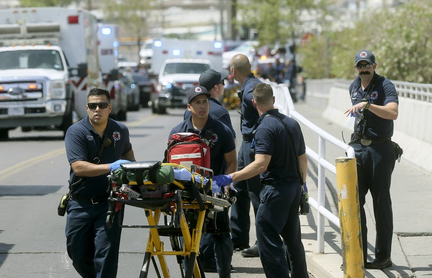 El Paso Fire Medical personnel arrive at the scene of a shooting at a Walmart near the Cielo Vista Mall in El Paso, Texas, Saturday, Aug. 3, 2019. (Mark Lambie/The El Paso Times via AP)