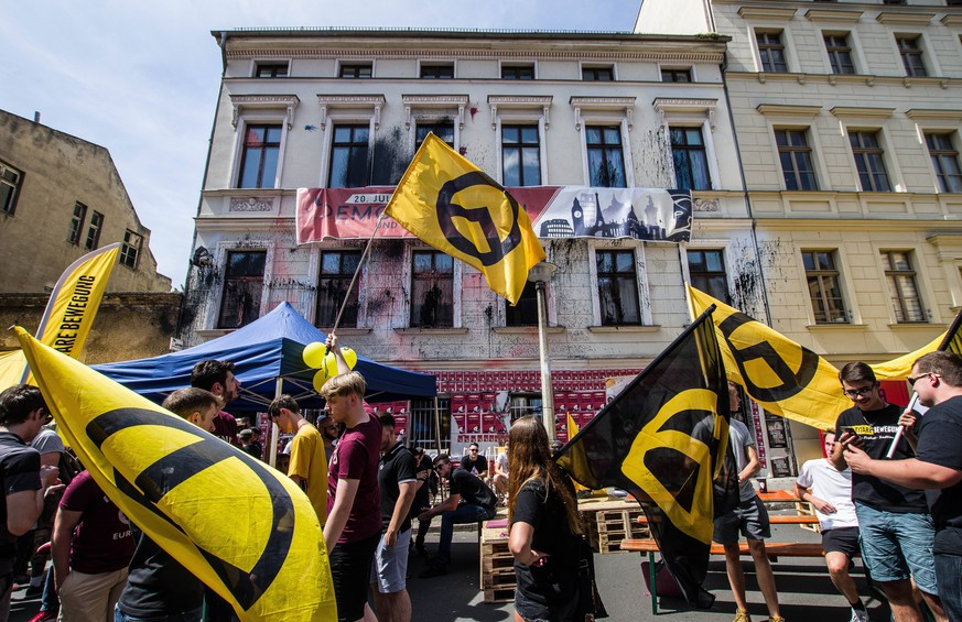 "July 20, 2019 - Halle Saale, Sachsen Anhalt, Germany - The Identitaere Bewegung Haus in Halle an der Saale, Germany. Amid protests, the white supremacist, right extremist Identitaere Bewegung (Generation Identity, Identitaren Movement) held a rally in Halle (Saale). The Identitaere have recently faced numerous challenges, including raids to explore the connection of its head Martin Sellner to the Christ Church shooter, as well as in Germany where the IB was officially classified as â€oeright-extremist"". The group has renewed the use of the â€oeblood and soil"" (Blut und Boden) theories and espouses a â€oegreat replacement"" of white people, which was directly cited by the Christ Church shooter, with whom IB head Martin Sellner had contacts. The IB promotes removal of all non-whites from Europe, including the d PUBLICATIONxINxGERxSUIxAUTxONLY - ZUMAb160 20190720_zbp_b160_044 Copyright: xSachellexBabbarx"