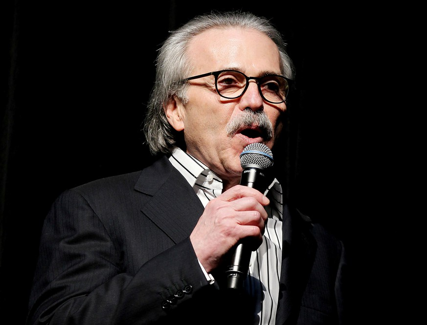 FILE PHOTO: David Pecker, Chairman and CEO of American Media, speaks at the Shape and Men's Fitness Super Bowl Party in New York City, U.S., January 31, 2014. Picture taken January 31, 2014.  REUTERS/Marion Curtis/File Photo