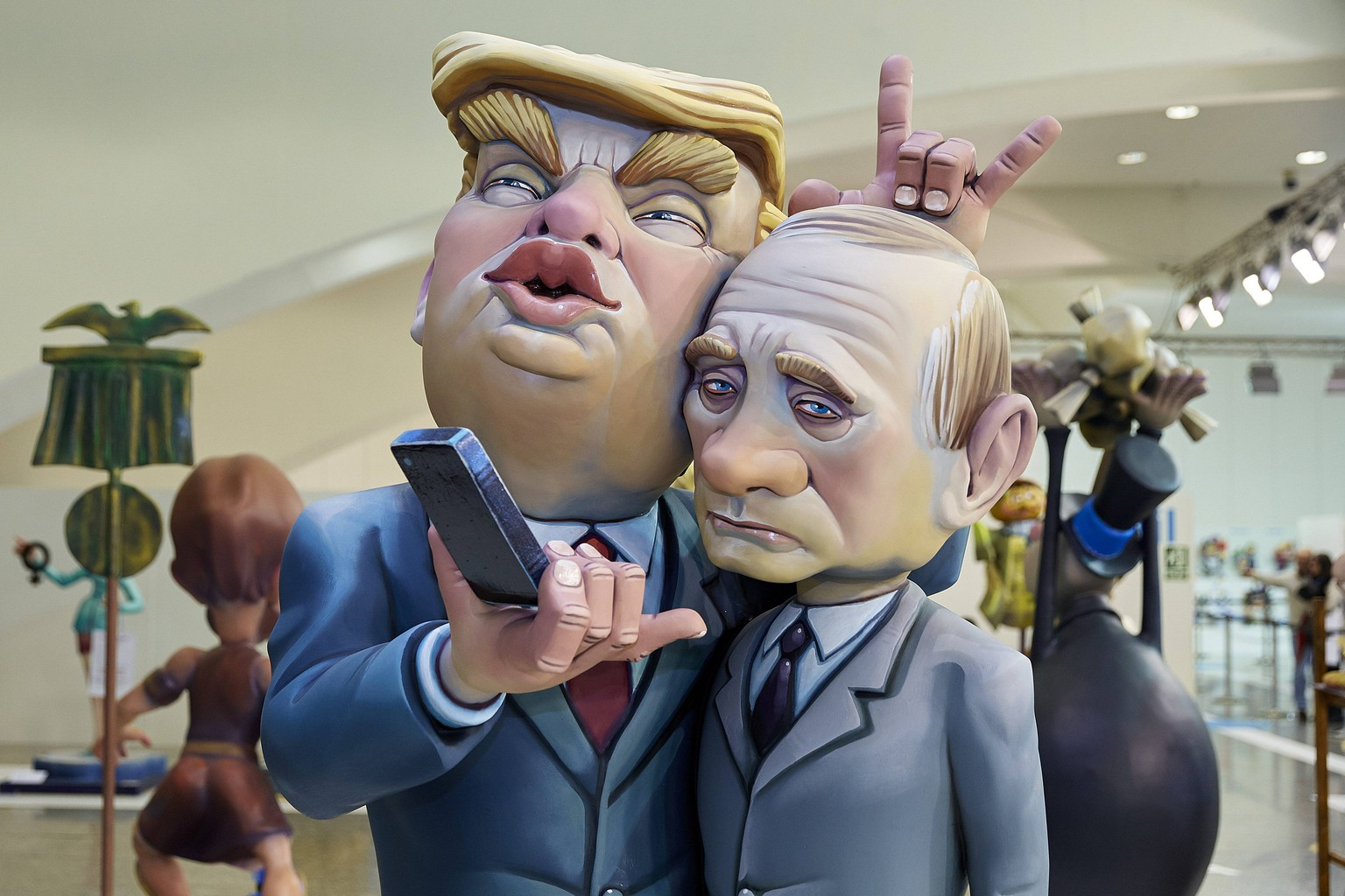 March 1, 2018 - Valencia, Valencia, Spain - A ninot (puppet) depicting United States President Donald Trump (L) and Russian Federation President Vladimir Putin t is displayed during the Ninot exhibition ahead of Las Fallas Festival at Museo de Las Ciencias Principe Felipe on March 1, 2018 in Valencia, Spain. The Fallas is Valencias most international festival, which runs from March 15 until March 19 and celebrates the arrival of spring with fireworks, fiestas and bonfires made by large puppets named Ninots. During the months preceding this unique festivity, a lot of hard work and dedication is put into preparing the monumental and ephemeral cardboard statues that will be devoured by the flames. The festival has been designated as a UNESCO Intangible Cultural Heritage of Humanity since 2016. Valencia Spain PUBLICATIONxINxGERxSUIxAUTxONLY - ZUMAn230 20180301_zaa_n230_327 Copyright: xDavidxAliagax