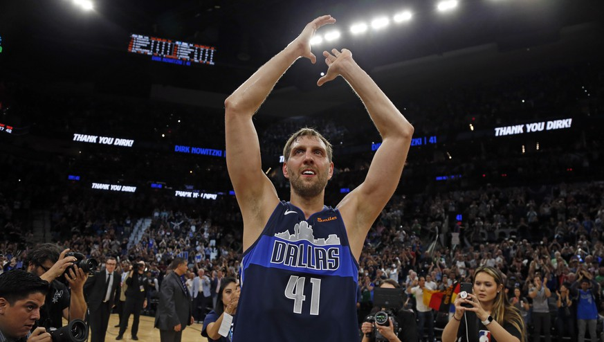 SAN ANTONIO, TX - APRIL 10:  Dirk Nowitzki #41 of the Dallas Mavericks acknowledges fans at the end of his last game against the San Antonio Spurs at AT&T Center on April 10, 2019 in San Antonio, Texas.  NOTE TO USER: User expressly acknowledges and agrees that , by downloading and or using this photograph, User is consenting to the terms and conditions of the Getty Images License Agreement. (Photo by Ronald Cortes/Getty Images)