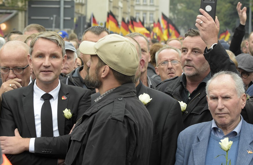FILE - In this Sept. 1, 2018 file photo  Bjoern Hoecke, left, leader of the Alternative for Germany, AfD, in German state of Thuringia, and Pegida founder Lutz Bachmann, second from right, participate in a commemoration march in Chemnitz, eastern Germany, Saturday, Sept. 1, 2018, after several nationalist groups called for marches protesting the killing of a German man last week, allegedly by migrants from Syria and Iraq. (AP Photo/Jens Meyer, file)