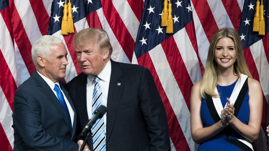 NEW YORK, NY - JULY 16: (L to R) Newly selected vice presidential running mate Mike Pence, governor of Indiana, stands with Republican presidential candidate Donald Trump as Ivanka Trump looks on during an event at the Hilton Midtown Hotel, July 16, 2016 in New York City. On Friday, Trump announced on Twitter that he chose Pence to be his running mate. (Photo by Drew Angerer/Getty Images)