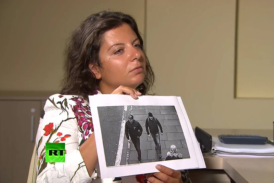 MOSCOW, RUSSIA - SEPTEMBER 13, 2018: RT Editor-in-Chief Margarita Simonyan shows an image of two men during an interview with Alexander Petrov and Ruslan Boshirov, who are suspected by the British authorities of poisoning former GRU officer Sergei Skripal and his daughter Yulia in Salisbury, United Kingdom in March 2018. RT video screengrab/TASS PUBLICATIONxINxGERxAUTxONLY TS090770