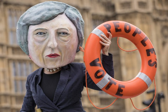 January 15, 2019 - London, London, UK - London, UK. A campaigner wearing a Theresa May mask stands on the bow of the HMS Brexit in Old Palace Yard opposite Parliament. MPs will vote on Prime Minister Theresa Mays Brexit deal this evening. London UK PUBLICATIONxINxGERxSUIxAUTxONLY - ZUMAl94_ 20190115_zaf_l94_080 Copyright: xRobxPinneyx