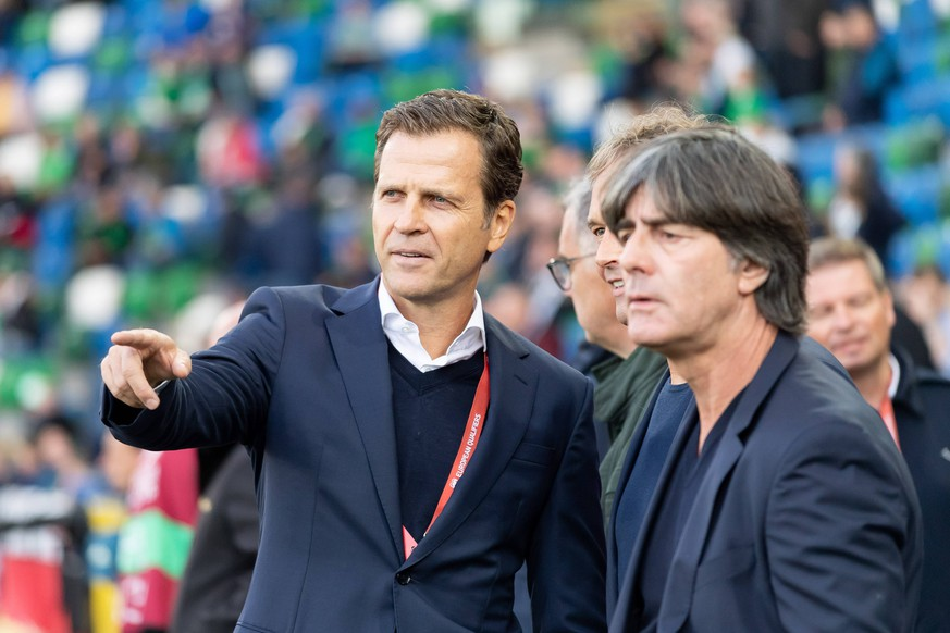 Belfast, Nordirland 09.09.2019, UEFA EM Qualifikation, Runde 6, Gruppe C, Nordirland - Deutschland, Manager Oliver Bierhoff (GER) und Trainer Joachim Loew (GER) Schaut, looks on ( Belfast Windsor Park Nordirland United Kingdom eu-images-01061010002 *** Belfast, Northern Ireland 09 09 2019, UEFA EM Qualification, Round 6, Group C, Northern Ireland Germany, Manager Oliver Bierhoff GER and Coach Joachim Loew GER Schaut, looks on Belfast Windsor Park Northern Ireland United Kingdom eu images 01061010002 eu-images-061 DFL REGULATIONS PROHIBIT ANY USE OF PHOTOGRAPHS AS IMAGE SEQUENCES AND/OR QUASI-VIDEO.