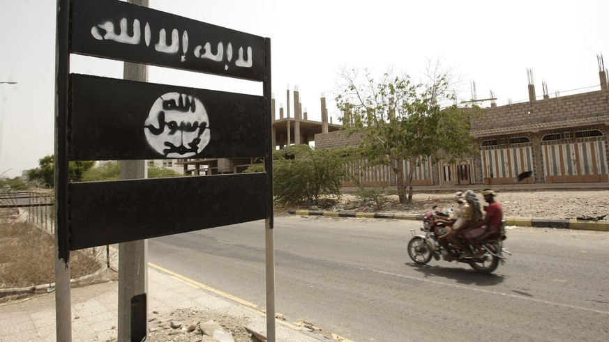 FILE - In this Friday, June 15, 2012 file photo, an al-Qaida logo is seen on a street sign in the town of Jaar in southern Abyan province, Yemen. Arabic on the logo reads,