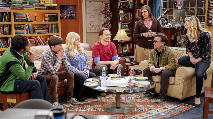 This image released by CBS shows Kunal Nayyar,  from left, Simon Helberg, Melissa Rauch, Jim Parsons, Mayim Bialik, Johnny Galecki and Kaley Cuoco appear in a scene from the long-running comedy series