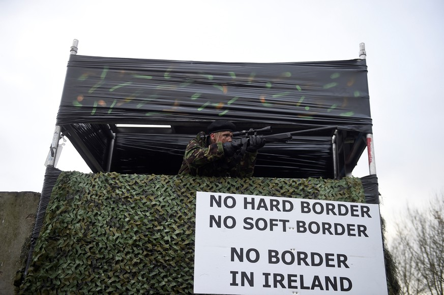 An actor dressed as a solider stands at a mock border barricade during a protest by anti-Brexit campaigners, Borders Against Brexit in Carrickcarnan, Ireland, January 26, 2019. REUTERS/Clodagh Kilcoyne