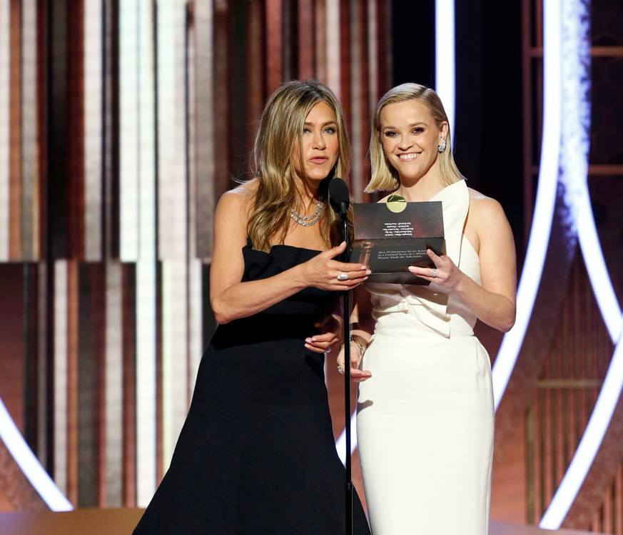 77th Golden Globe Awards - Show - Beverly Hills, California, U.S., January 5, 2020 - Jennifer Aniston (L) and Reese Witherspoon.  Paul Drinkwater/NBCUniversal/Handout via REUTERS For editorial use only. Additional clearance required for commercial or promotional use, contact your local office for assistance. Any commercial or promotional use of NBCUniversal content requires NBCUniversal's prior written consent. No book publishing without prior approval. NO SALES. NO ARCHIVES.