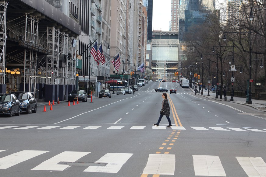 April 1, 2020, New York, New York, USA: An unprecedented situation in Big Apple. This young woman is crossing the notorious 5th Avenue emptied of cars as New York became the epicenter of the Coronavirus. The city s coronavirus toll continued its dramatic rise with more than 4,000 new cases and over 200 more deaths in the past 24 hours. NYC now has 44,915 confirmed COVID-19 cases and 1 400 deaths. New York USA - ZUMAb197 20200401shab197506 Copyright: xMariexLexBlex