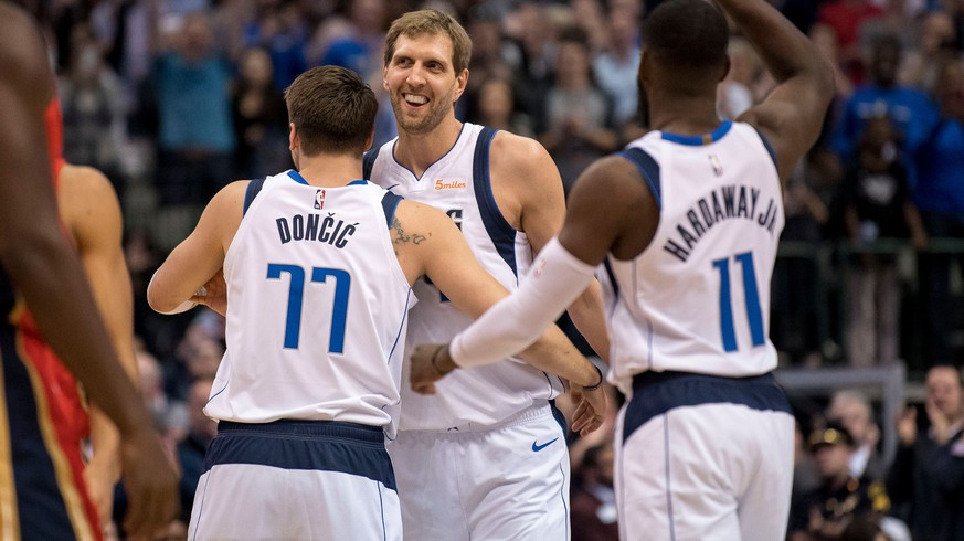 Mar 18, 2019; Dallas, TX, USA; Dallas Mavericks forward Luka Doncic (77) and forward Dirk Nowitzki (41) and guard Tim Hardaway Jr. (11) celebrate Nowitzki becoming the sixth all-time leading scorer in NBA history during the first quarter against the New Orleans Pelicans at the American Airlines Center. Mandatory Credit: Jerome Miron-USA TODAY Sports