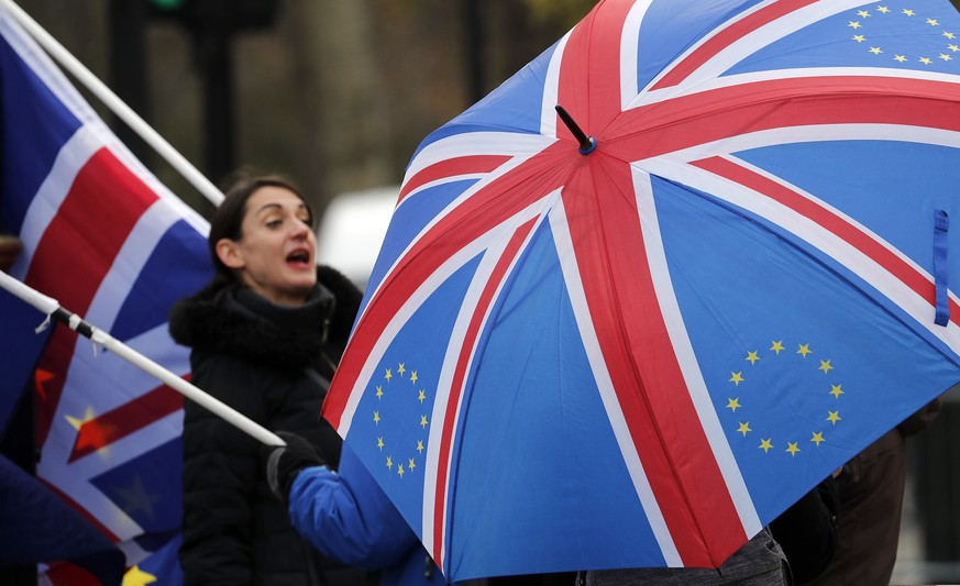 Protestors shout against Brexit opposite the House of Parliament in London, Tuesday, Nov. 27, 2018. Prime Minister Theresa May made a blunt appeal to skeptical lawmakers on Monday to back her divorce deal with the European Union: It isn't perfect, but it's all there is, and the alternative is a leap into the unknown. (AP Photo/Frank Augstein)