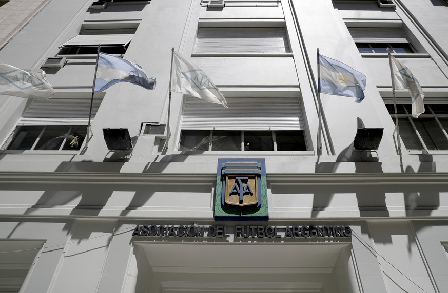 Flags fly in front of the Argentine Football Association, AFA, headquarters, in Buenos Aires, Argentina, Thursday, Nov. 16, 2017. The former CEO of the sports marketing company Torneos y Competencias Alejandro Burzaco, testified on Tuesday that former President of the AFA Julio Grondona, demanded bribes to help cover what he was owed for his 2010 vote that helped Qatar land the tournament.(AP Photo/Natacha Pisarenko) |