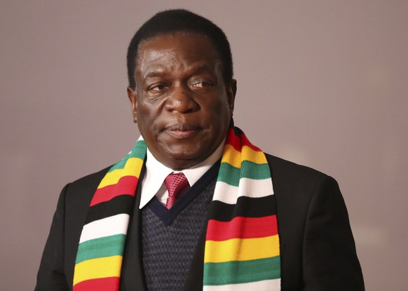 In this July 27, 2018, file photo, Zimbabwe's President Emmerson Mnangagwa attends the BRICS Summit in Johannesburg, South Africa. Zimbabwe's electoral commission said Friday, Aug. 3, Mnangagwa has won in Monday's election as the ruling party maintains control of the government in the first vote after the fall of longtime leader Robert Mugabe. (Mike Hutchings/Pool Photo via AP, File)