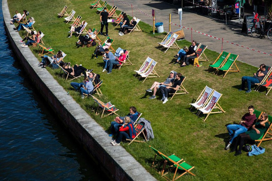 BERLIN, GERMANY - MAY 26: Visitors sit in a bar on chairs that are set apart to provide social distance during the coronavirus crisis on May 26, 2020 in Berlin, Germany. (Photo by Maja Hitij/Getty Images)