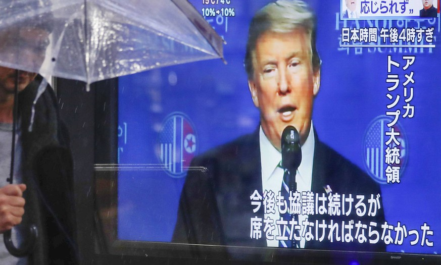 Trump-Kim summit A public screen in Tokyo on Feb. 28, 2019, shows a TV broadcast reporting that U.S. President Donald Trump and North Korean leader Kim Jong Un could not reach an agreement on denuclearization at their two-day summit in Hanoi. PUBLICATIONxINxGERxSUIxAUTxHUNxONLY