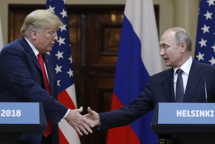 U.S. President Donald Trump, left, shakes hand with Russian President Vladimir Putin during a press conference after the meeting of U.S. President Donald Trump and Russian President Vladimir Putin at the Presidential Palace in Helsinki, Finland, Monday, July 16, 2018. (AP Photo/Alexander Zemlianichenko)