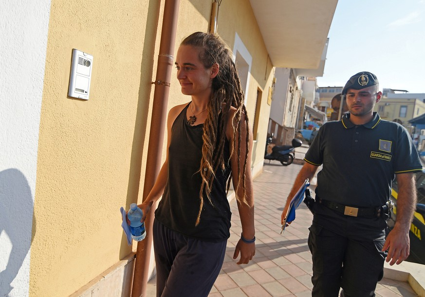 Carola Rackete, the 31-year-old Sea-Watch 3 captain is seen arriving at the Finance police headquarters in Lampedusa, Italy June 29, 2019. REUTERS/Guglielmo Mangiapane