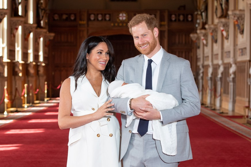 Britain's Prince Harry and Meghan, Duchess of Sussex are seen with their baby son, who was born on Monday morning, during a photocall in St George's Hall at Windsor Castle, in Berkshire, Britain May 8, 2019. Dominic Lipinski/Pool via REUTERS