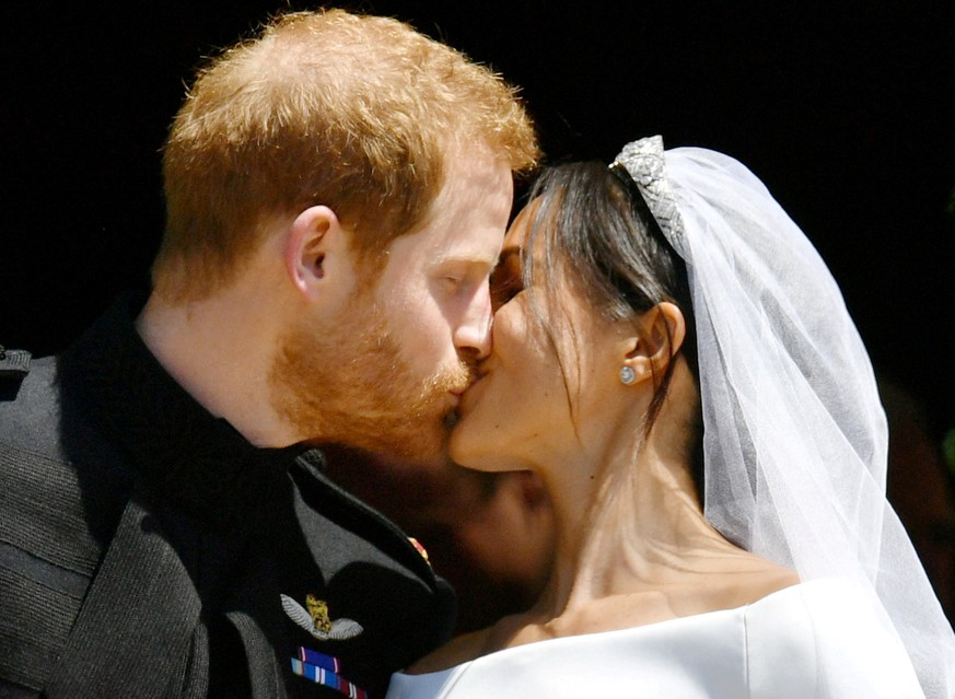 Prince Harry and Meghan Markle kiss on the steps of St George's Chapel in Windsor Castle after their wedding in Windsor, Britain, May 19, 2018.  Ben Birchall/Pool via REUTERS     TPX IMAGES OF THE DAY