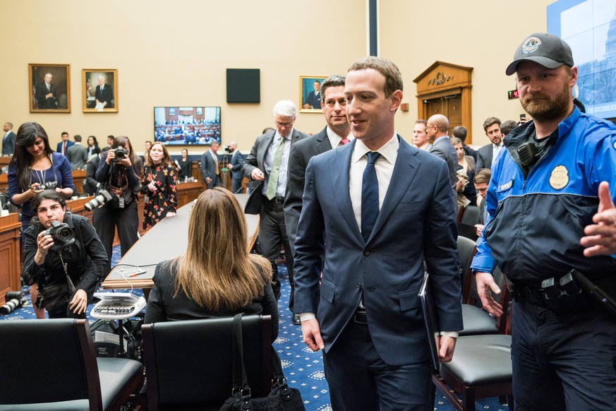 Facebook co-founder and CEO Mark Zuckerberg walks away from his seat during a break from testifying before a House Energy and Commerce Committee hearing on transparency and use of consumer data on Capitol Hil in Washington, DC on April 11, 2018. The hearing marks Zuckerberg s second day of testimony on Capitol Hill following relevations that millions of Facebook users had their personal information improperly used by Cambridge Analytica, a consulting firm linked to the Trump presidential campaign. PUBLICATIONxINxGERxSUIxAUTxHUNxONLY WAS20180411544 ERINxSCHAFF