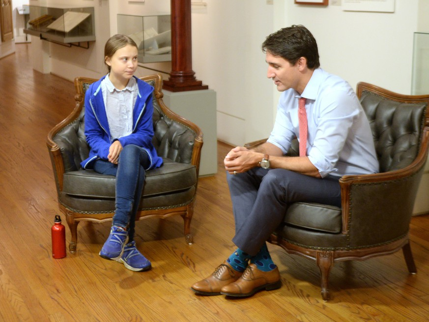 THE CANADIAN PRESS 2019-09-27. Canadian Prime Minister and Liberal leader Justin Trudeau speaks Swedish environmental activist Greta Thunberg in Montreal on Friday, September 27, 2019. THE CANADIAN PRESS/Ryan Remiorz URN:45627930 |