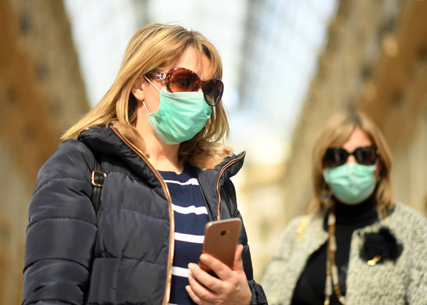 200224 -- MILAN, Feb. 24, 2020 Xinhua -- People wearing masks are seen in Milan, Italy, on Feb. 24, 2020. Six people have died and 222 have tested positive for the novel coronavirus COVID-19 nationwide in Italy, Angelo Borrelli, chief of Civil Protection Department and Extraordinary Commissioner for the Coronavirus Emergency, told a press conference at 6 p.m. local time on Monday. Photo by Daniele Mascolo/Xinhua ITALY-MILAN-COVID-19-CONFIRMED CASES-RISE PUBLICATIONxNOTxINxCHN